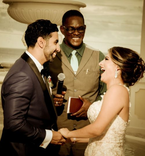 Laughing couple during marriage ceremony